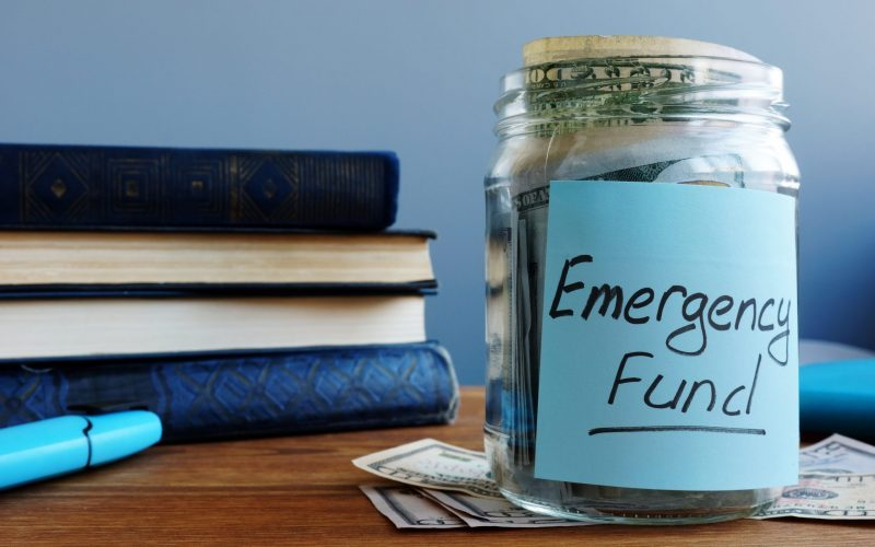 Emergency fund written on a jar with money.