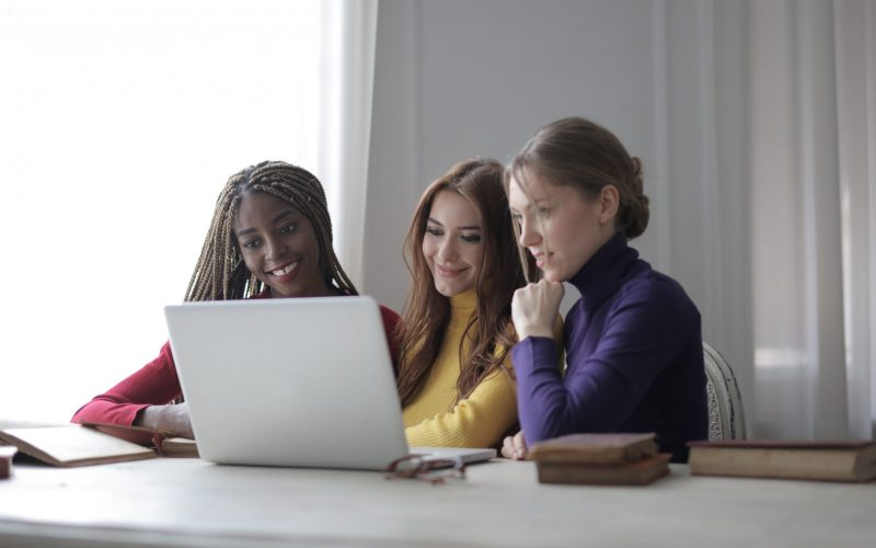 Canva - Women Looking At A Laptop